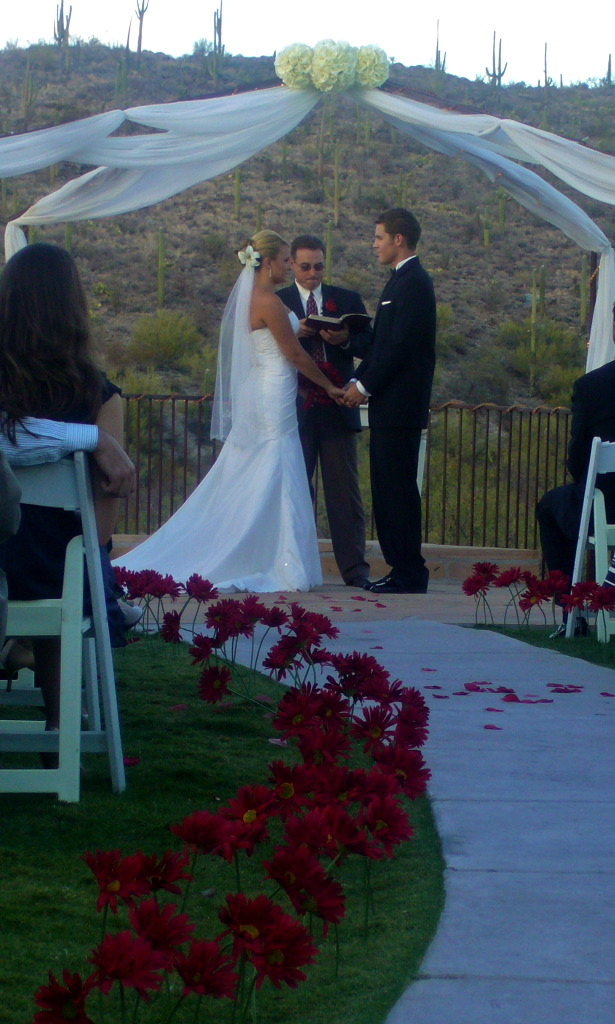 Here is one way to beautify your outdoor wedding Red silk flowers were