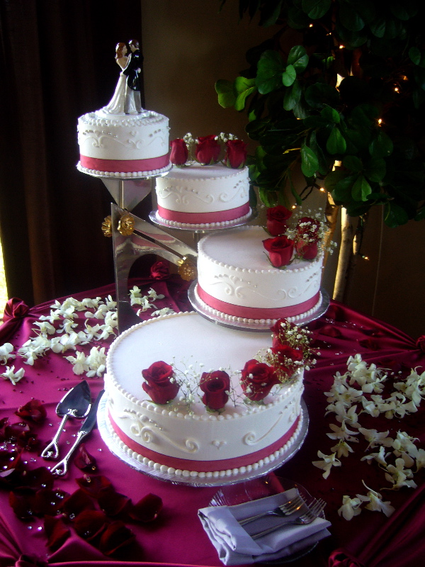 Beautiful wedding cake my tucson wedding a beautiful tiered wedding cake with red roses on white made this an elegant display at saguaro buttes this month wedding cakes can add to the decor of the junglespirit Choice Image
